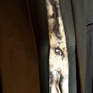 Leather tie with glass eye